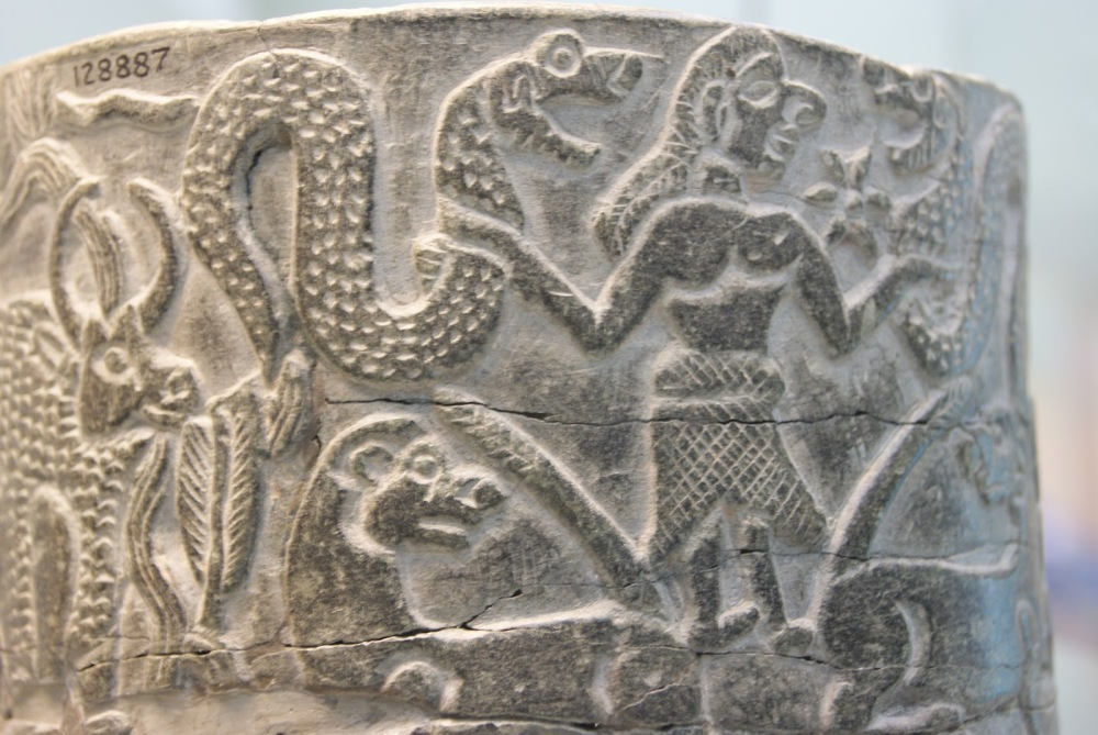 Ishtar-in-the-Sumerian-creation-myth-with-two-snakes-and-a-6-pointed-star-and-lions